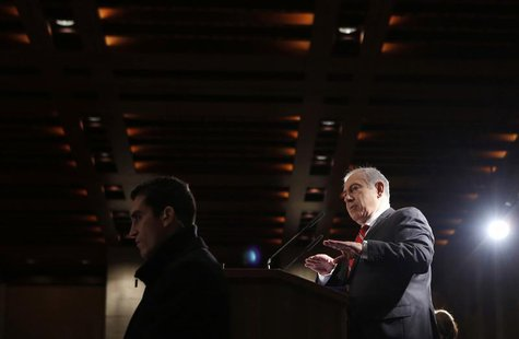 Israel's Prime Minister Benjamin Netanyahu (R) addresses a meeting of the Jewish Agency's Board of Governors in Jerusalem February 18, 2013.