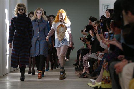 Vivienne Westwood joins her models on the catwalk after the Vivienne Westwood Red Label Autumn/Winter 2013 collection presentation during Lo