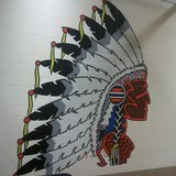 Indian Head painted on wall of Saugatuck High School