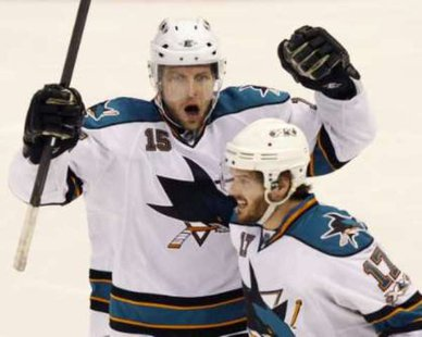 DIFFERENT UNIFORMS, SAME REACTION: Torrey Mitchell (17) and Dany Heatley (15) celebrate a San Jose Sharks goal against the Detroit Red Wings during 2011 Stanley Cup Playoff Action. The two teamed up to score against the Wings for the Minnesota Wild in a 3-2 win on Feb. 17, 2013. REUTERS/Rebecca Cook