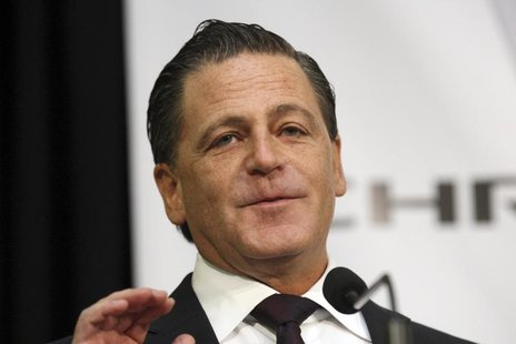 Dan Gilbert, chairman of Rock Ventures and Quicken Loans, addresses the crowd during an announcement that Chrysler Group will move some of i
