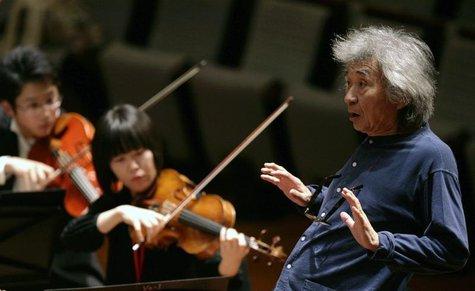 Maestro Seiji Ozawa conducts the Seiji Ozawa Ongaku-juku orchestra during a rehearsal at the National Theatre in Beijing April 15, 2009. REU