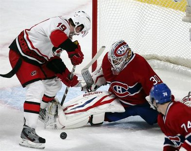 Montreal Canadiens goalie Peter Budaj (30) makes a save against Carolina Hurricanes Jiri Tlusty (19) during first period NHL hockey action i