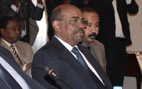 Sudan's President Omar Hassan al-Bashir attends a meeting with leaders from South Sudan at the National Palace in the Ethiopian capital Addi