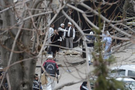 Turkish police forensic experts inspect the site after an explosion at the entrance of the U.S. embassy in Ankara February 1, 2013. REUTERS/