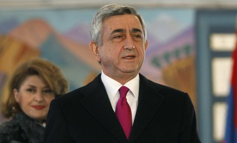 Armenia's current President Serzh Sarksyan (R) and his wife Rita leave a polling station after voting during the presidential election in Ye