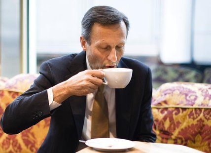 Daniel Vasella, chairman of Swiss drugmaker Novartis, drinks coffee before the annual news conference in Basel, January 23, 2013. Novartis s