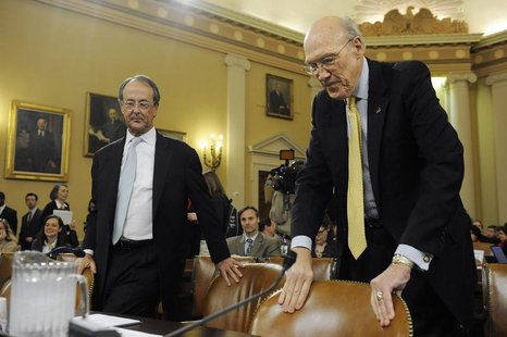 Erskine Bowles (L) and Alan Simpson (R), co-chairmen of the National Commission on Fiscal Responsibility and Reform, take their seats to tes
