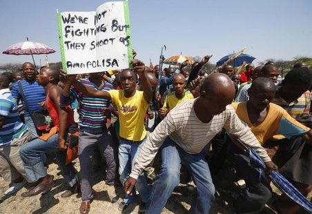 File photo of striking platinum miners march near the Anglo-American Platinum (AMPLATS) mine near Rustenburg in South Africa's North West Pr