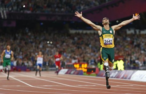 Oscar Pistorius of South Africa celebrates winning the Men's 400m T44 Final during the London 2012 Paralympic Games at the Olympic Stadium i