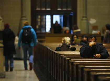 Catholics pray during a mass at St. Patrick's Cathedral in New York, February 11, 2013. REUTERS/Brendan McDermid