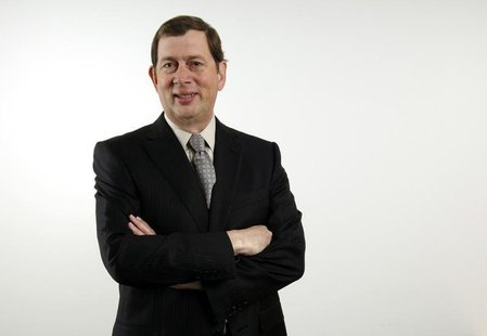 John Martin, CEO of Gilead, poses before speaking to reporters during the Reuters 2006 Biotechnology Summit in Los Angeles February 23, 2006
