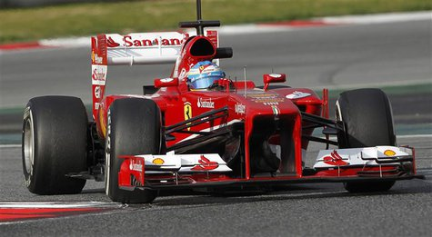 Ferrari's Formula One driver Fernando Alonso of Spain takes a curve during a training session at the Circuit de Catalunya racetrack in Montm