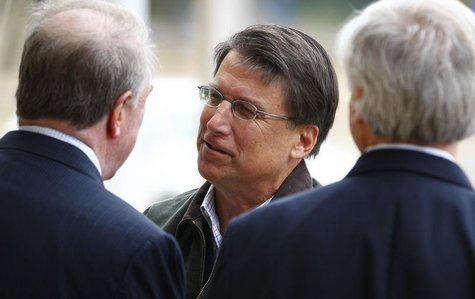 Pat McCrory meets supporters outside Myers Park Traditional Elementary school during the U.S. presidential election in Charlotte, North Caro