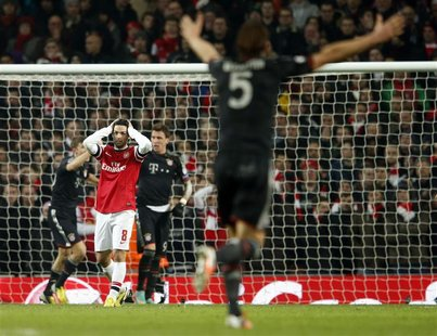 Arsenal's Mikel Arteta reacts after Bayern Munich scored a third goal during their Champions League soccer match at the Emirates Stadium in