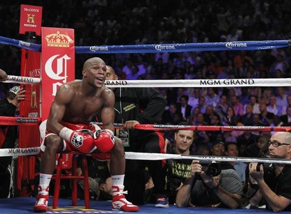 Floyd Mayweather Jr. of the U.S. sits on a stool as he waits for a round to start during his title fight against WBA super welterweight cham