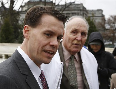 Mark Walters (L), attorney for Indiana soybean farmer Vernon Bowman (R), speaks to the media outside the Supreme Court in Washington, Februa