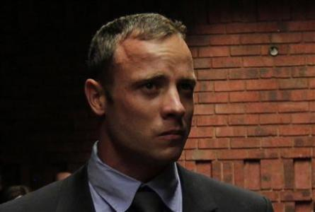 ''Blade Runner'' Oscar Pistorius awaits the start of court proceedings in the Pretoria Magistrates court February 19, 2013. Pistorius, a double amputee who became one of the biggest names in world athletics, was applying for bail after being charged in court with shooting dead his girlfriend, 30-year-old model Reeva Steenkamp, in his Pretoria house. Credit: Reuters/Siphiwe Sibeko