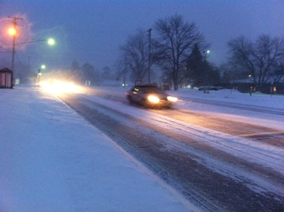 Vehicles navigate a snow covered West Main Street in Kalamazoo on February 19th, 2013.