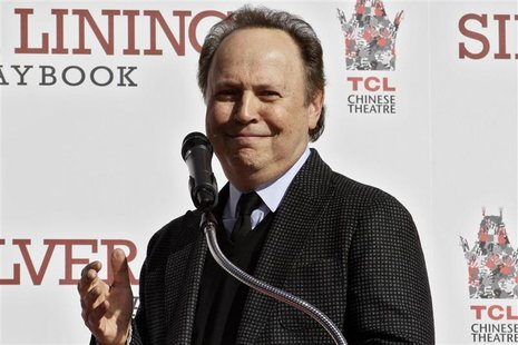Actor Billy Crystal speaks during a hand and footprint ceremony for actor Robert DeNiro at the TCL Chinese Theatre in Hollywood, California,