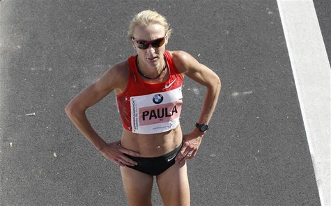 Britain's Paula Radcliff reacts after finishing third in the 38th Berlin Marathon in Berlin, September 25, 2011. REUTERS/Fabrizio Bensch
