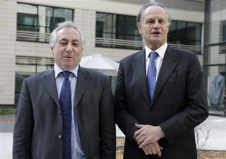 Credit Agricole Chief Executive Jean-Paul Chifflet (R) and Chairman Jean-Marie Sander pose for photographers before the French bank's 2012 a
