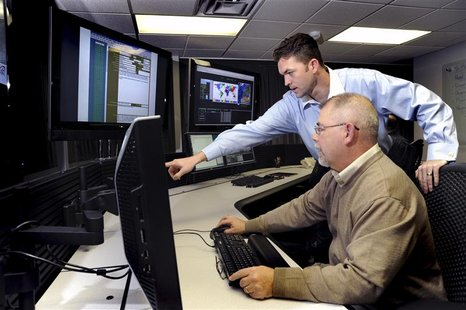 U.S. Department of Homeland Security (DHS) employees work on the Industrial Control Systems Cyber Emergency Response Team (ICS-CERT) operati