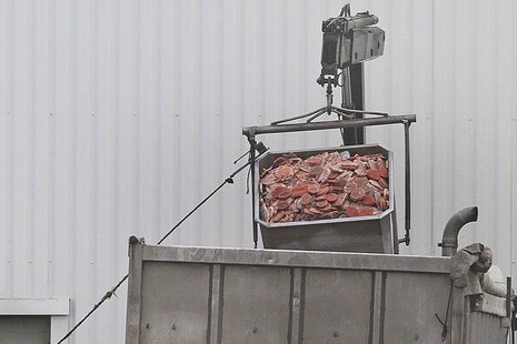 A dump truck is filled up with blocks of meat at French meat processor Spanghero's factory in Castelnaudary near Toulouse, southwestern Fran