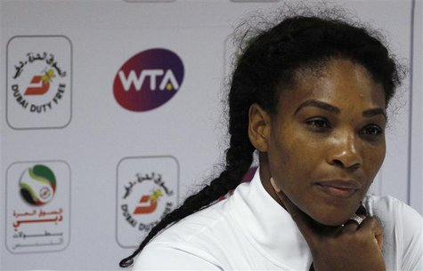 Serena Williams of the U.S. listens during a news conference at the WTA Dubai Tennis Championships in Dubai February 20, 2013. REUTERS/Juman