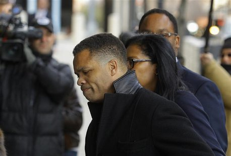 Former Chicago congressman Jesse Jackson Jr. (C) enters the U.S. District Federal Courthouse in Washington February 20, 2013. REUTERS/Gary C