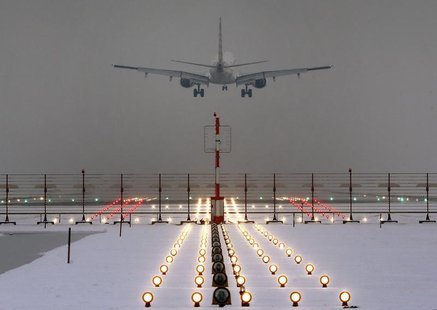 A German Lufthansa plane lands at Munich's international airport early January 25, 2013. REUTERS/Michael Dalder