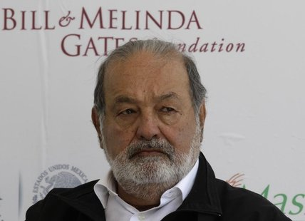 Mexican businessman Carlos Slim listens during a news conference after the inauguration of a new research facility at the International Maiz