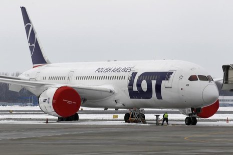 A Dreamliner belonging to Polish airline LOT is being parked on the tarmac at Chopin International Airport in Warsaw February 13, 2013. REUT