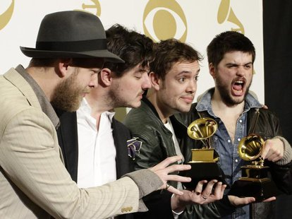 "Mumford & Sons pose with their awards for Album of the Year for ""Babel"" and Best Long Form Music Video for ""Big Easy Express"" backstage at t"
