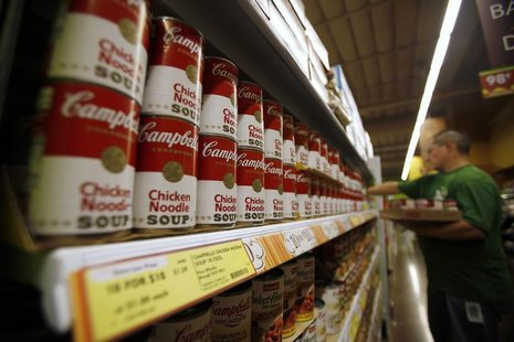 A worker restocks Campbell's soup cans inside a Fresh & Easy store in Burbank, California October 19, 2012. Picture taken October 19, 2012.