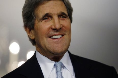 U.S. Secretary of State John Kerry smiles following his meeting with Canada's Foreign Minister John Baird (not pictured) at the State Depart