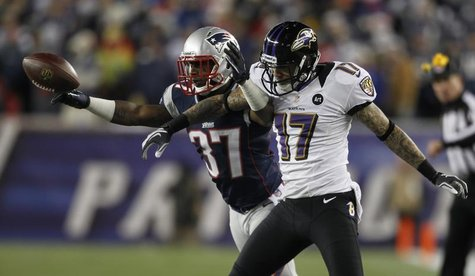 New England Patriots corner back Alfonzo Dennard (L) breaks up a pass intended for Baltimore Ravens wide receiver Tandon Doss during the thi