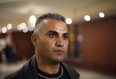 "Palestinian journalist Emad Burnat pauses while he speaks to members of the media before a screening of his Oscar-nominated documentary ""5 B"