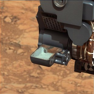 The first sample of powdered rock from Mars extracted by the NASA's Curiosity rover drill is pictured in this February 20, 2013 NASA handout