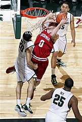 Indiana's Will Sheehey (0) shoots against Michigan State's Travis Trice (20) as Derrick Nix (25) and Denzel Valentine watch during the first half of an NCAA college basketball game, Tuesday, Feb. 19, 2013, in East Lansing, Mich. (AP Photo/Al Goldis)