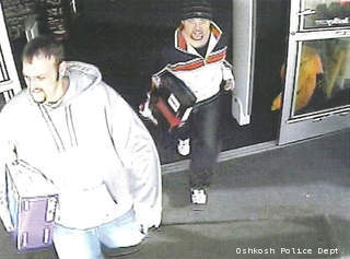 This surveillance photo shows two men suspected of stealing electronics from Best Buy in Oshkosh, Feb. 18, 2013.