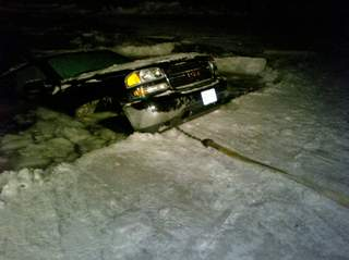 Truck falls through the ice on Lake Winnebago. (courtesy of FOX 11).
