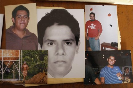 Photographs of five of the six young men abducted by soldiers are seen at a desk in Iguala, in the Mexican state of Guerrero February 20, 20