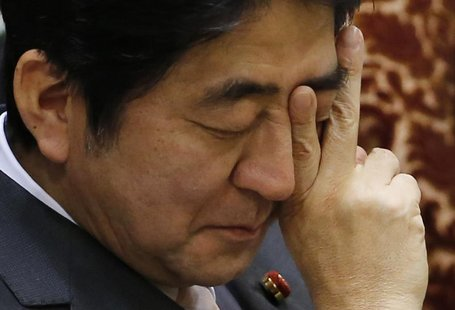 Japan's Prime Minister Shinzo Abe attends an upper house budget committee session at the parliament in Tokyo February 19, 2013. REUTERS/Toru