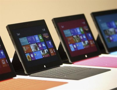 New Surface tablet computers with keyboards are displayed at its unveiling by Microsoft in Los Angeles, California, June 18, 2012. REUTERS/D