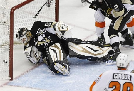 Pittsburgh Penguins goalie Tomas Vokoun (L) watches a puck shot by Philadelphia Flyers Tomas Voracek (not seen) go into the net in the third