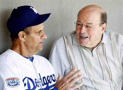 Los Angeles Dodgers head coach Joe Torre (L) talks to Joe Garagiola Sr. before playing the Chicago White Sox in a MLB spring training game i