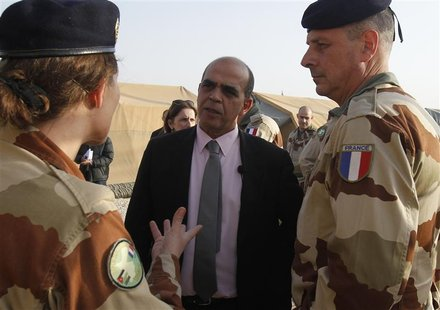 French Minister for Veteran Affairs Kader Arif (C) speaks to members of a French military field hospital at the Al Zaatri refugee camp in th