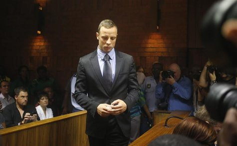 Oscar Pistorius enters the dock during a break in court proceedings at the Pretoria Magistrates court, February 21, 2013. REUTERS/Mike Hutch