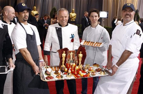 Celebrity chef Wolfgang Puck (C) and his staff display their Oscar creations on the red carpet at the 84th Academy Awards in Hollywood, Cali